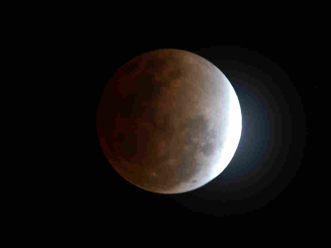 The moon seen from Manila, Philippines, during a total lunar eclipse in December 2012, as the Earth casts a shadow across the face of our nearest celestial neighbor.