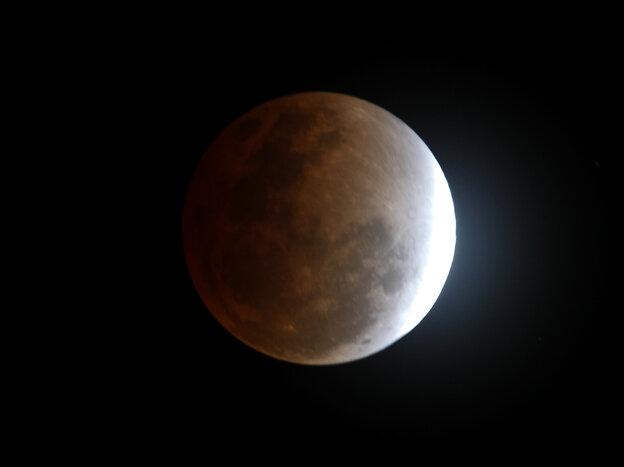 The moon seen from Manila, Philippines, during a total lunar eclipse in December 2012, as the Earth casts a shadow across the face of our n