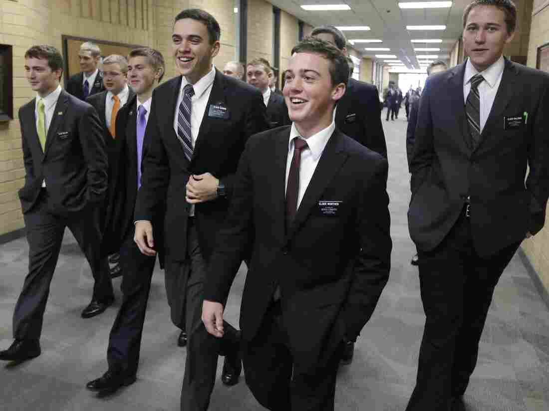 """Mormon missionaries walk through the halls at the Missionary Training Center in Provo, Utah, in January 2013. A new survey by Carnegie Mellon University shows that more millennials report they """"talk to God"""" than turn to religion for guidance."""