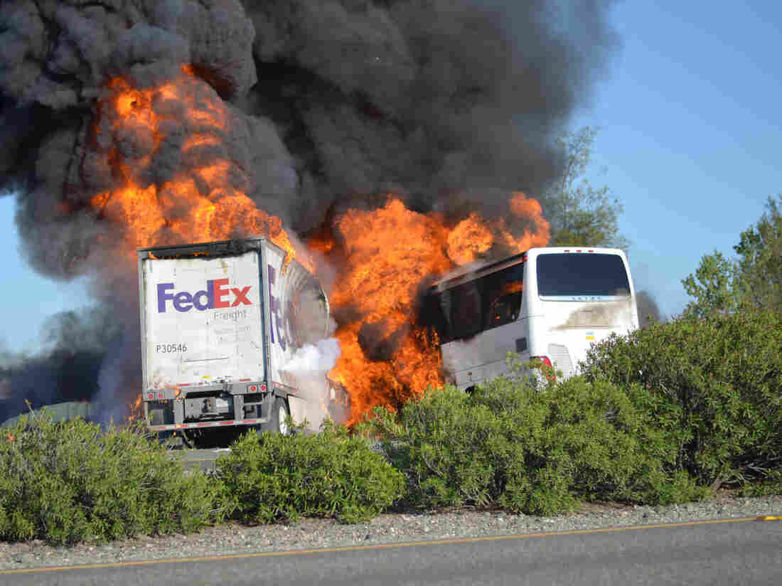 Flames devoured both vehicles just after a FedEx truck hit a charter bus Thursday in Northern California. At least 10 people were killed. The bus was carrying high school students who were going to visit a college.