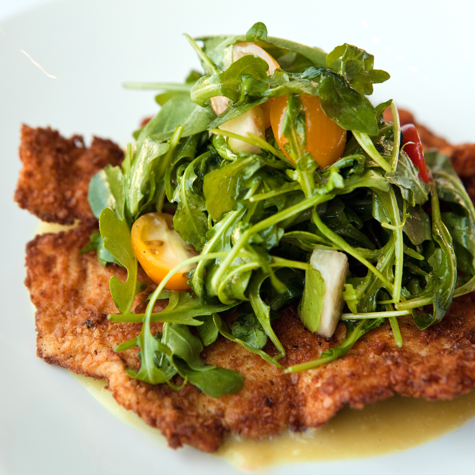 Crispy matzo-breaded chicken breast with a salad of arugula, tomatoes and jícama with tamarind vinaigrette and salsa verde.