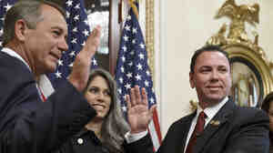 Louisiana Republican Rep. Vance McAllister with his wife, Kelly, as he's sworn in by Speaker John Boehner.