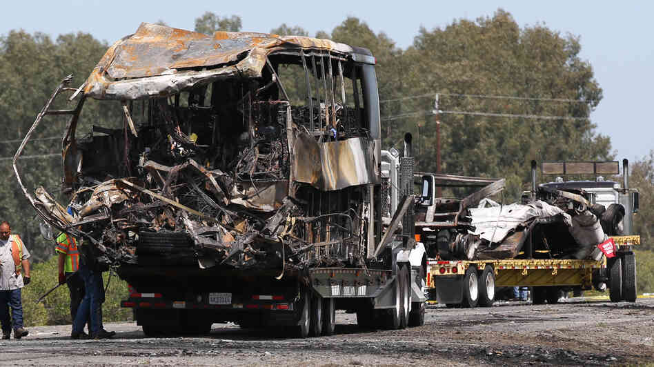 The remains of a FedEx truck (right) and a bus involved in a crash Thursday are taken from the scene of the accident in Orland, Calif., by flatbed trucks on Friday. The students had been on their way to visit Humboldt State University in Northern California.