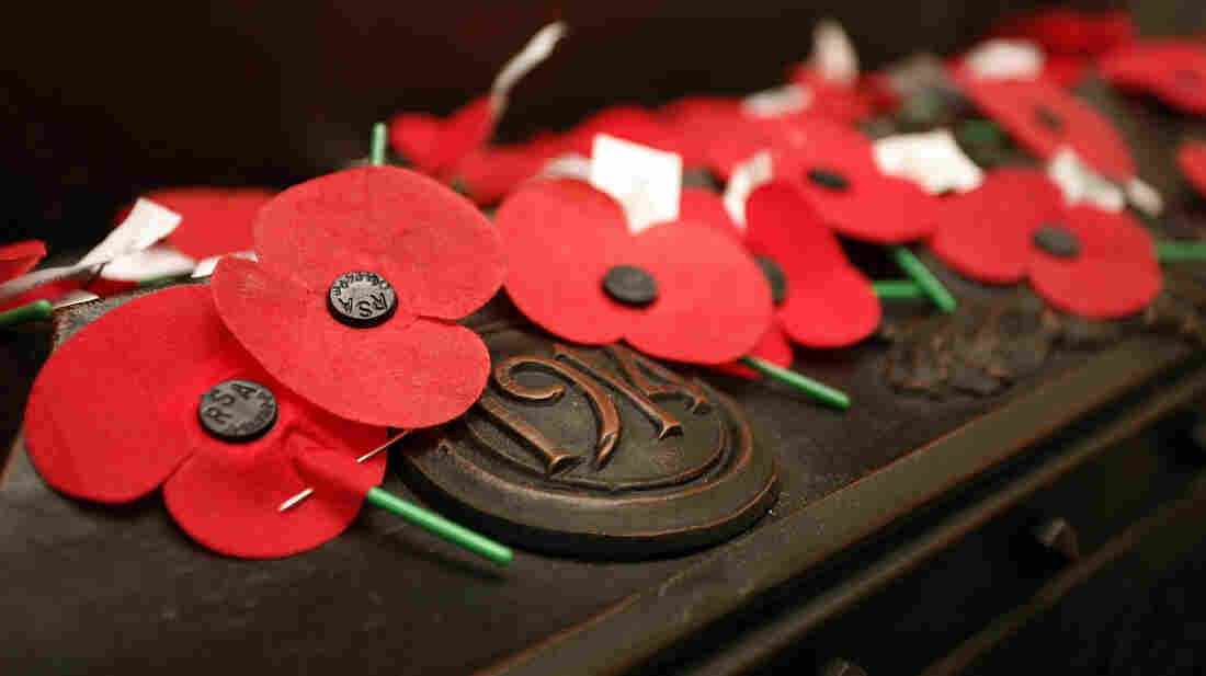 Remembrance poppies honoring veterans cover a shrine in Wellington, New Zealand, on a recent April 25, when Australia and New Zealand mark ANZAC Day. A new campaign urges people to buy a minute of silence to support veterans.
