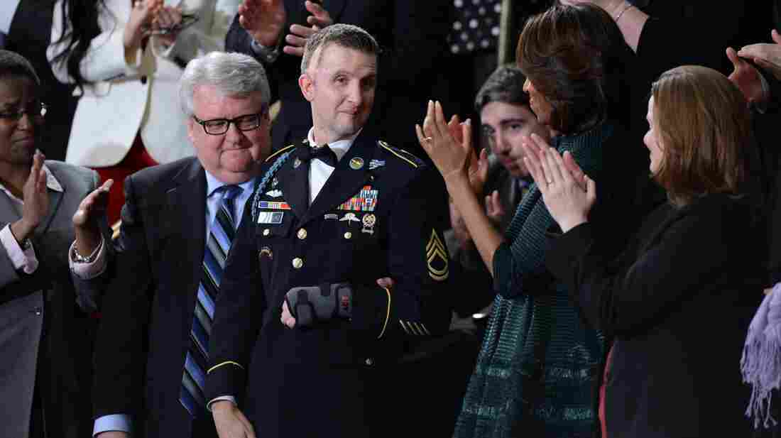 Craig Remsburg (left) remembers fondly the day his son, Army Ranger Sgt. 1st Class Cory Remsburg (center) received a standing ovation at the State of the Union speech in January. Cory was injured while serving in Afghanistan.