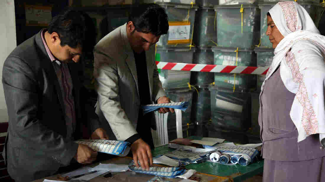 Initial results released by Afghan officials show former foreign minister Abdullah Abdullah with a narrow lead over former finance minister Ashraf Ghani, in a tight presidential election.