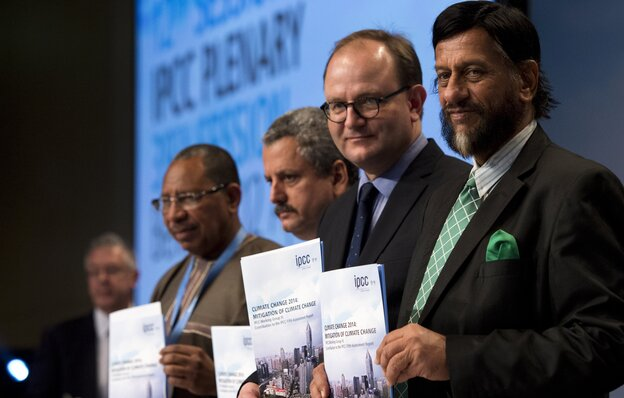 The world must cut its greenhouse gas emissions to meet its goals, climate experts said Sunday. Members of the Intergovernmental Panel on Climate Change (left to right) Youba Sakona, Ramon Pichs Madruga, Ottmar Edenhofer and Rajendra Pachauri hold copies of their new report in Berlin.