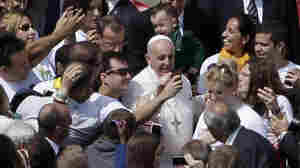 Pope Francis Poses For Selfies With Crowd At St. Peter's