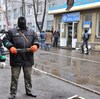 """A Pro-Russian force guards a barricade outside a regional police building seized by armed men in Slovyansk Sunday. Ukraine, which launched an """"anti-terrorist operation"""" in the eastern town, says one of its officers has been killed in a clash near the town."""