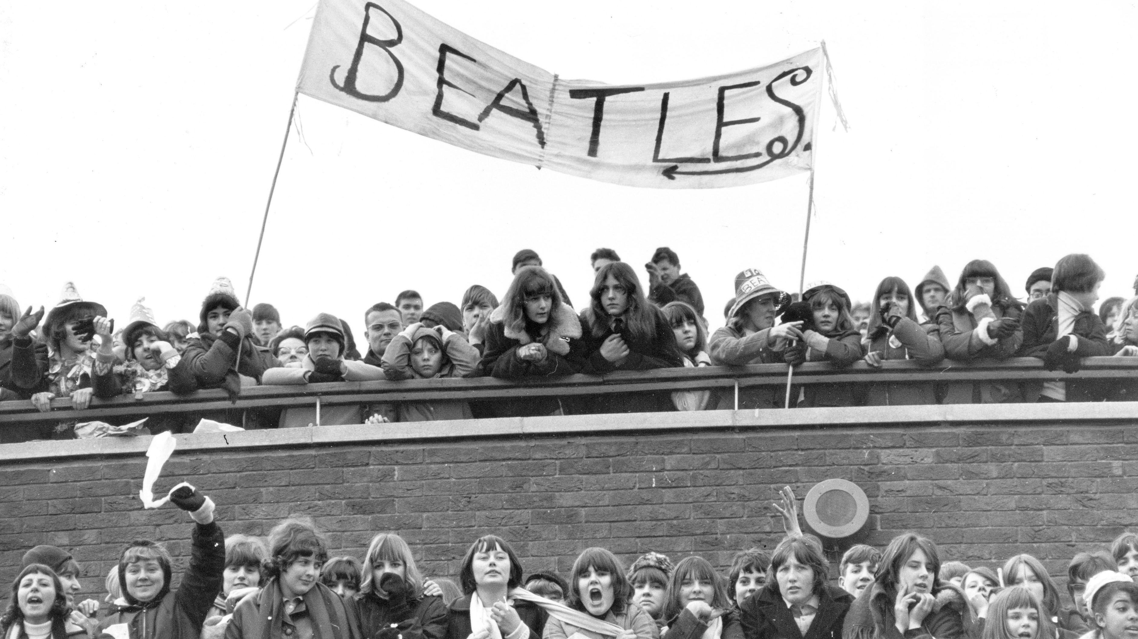 22nd February 1965: A crowd of fans of British pop group The Beatles at London Airport, where the group is due to take a flight to the Bahamas to film 'Help!'. (Photo by Central Press/Getty Images)
