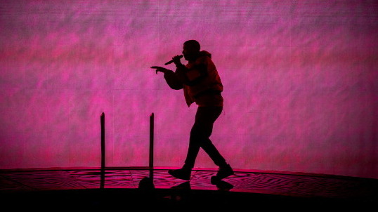 "NOTTINGHAM, UNITED KINGDOM - MARCH 16: Drake performs onstage during a date of his ""Nothing Was the Same"" 2014 World Tour at Nottingham Capital FM Arena on March 16, 2014 in Nottingham, England. (Photo by Ollie Millington/WireImage)"