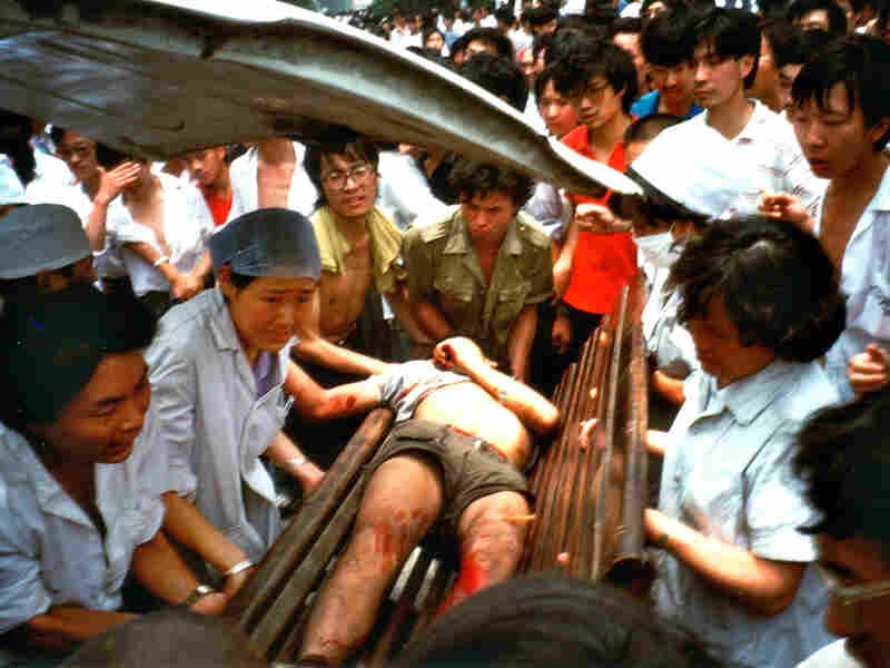 On June 4, a badly injured man is carried into a Chengdu hospital. Witnesses described scenes of police brutality, where people were beaten unconscious simply for being in the wrong place at the wrong time.