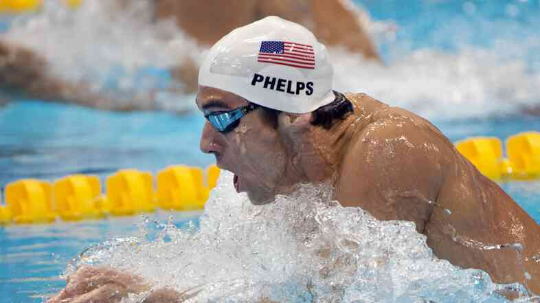 Michael Phelps swims in the men's 200-meter individual medley heat at the 2012 Summer Olympics in London.