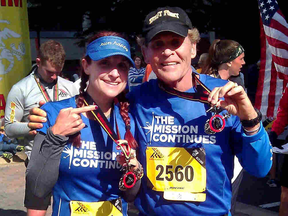 Demi Clark and her father, Howard Kympton, celebrate after running the Marine Corps Marathon in October. A family proud of its military heritage, they ran in support of an organization called The Mission Continues that matches veterans with service projects in the United States. Demi's brother Spencer Kympton helps run the charity.