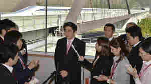 Japanese Prime Minister Shinzo Abe speaks to reporters after inspecting a maglev train system at the Yamanashi Experiment Center in Tsuru Saturday. Japan is reportedly willing to send the technology to the U.S. without a fee.