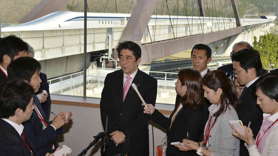 Japanese Prime Minister Shinzo Abe speaks to reporter