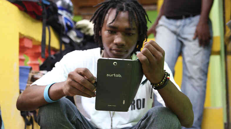 Haitian artist Richard Josue uses a Surtab tablet.