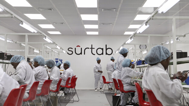 Workers assemble Android-based tablets from imported components a