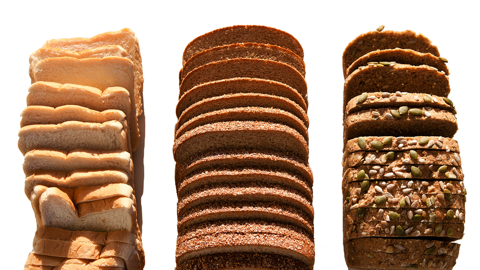The most healthful loaves of bread contain chunks of grain still intact, like the seeded loaf on the right. Whole wheat loaves, like the one in the middle, may contain few whole grains and may be made up mostly of refined flour, like the white bread on the left. (Meg Vogel/NPR)
