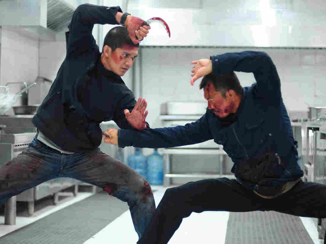 Iko Uwais as Rama and Cecep Arif Rahman in The Raid 2.