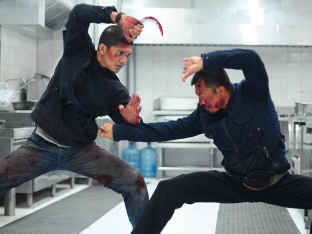Iko Uwais as Rama and Cecep Arif Rahman in The Raid 2.