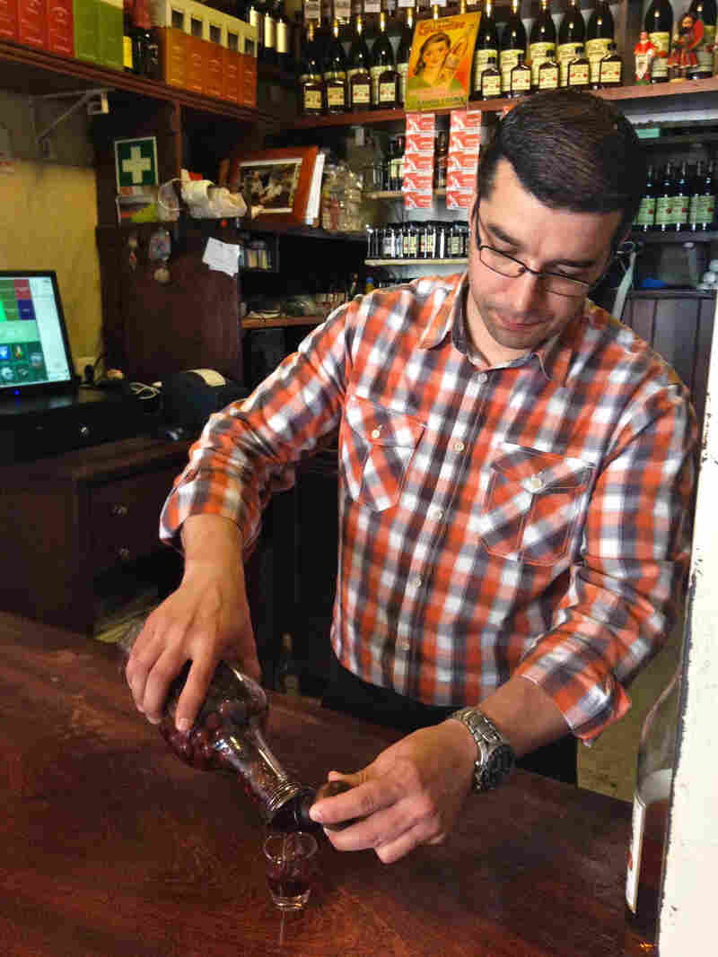 Nuno Goncalves pours out 50-cent glasses of Portuguese ginja — sweet cherry liqueur — in his tiny historic shop in downtown Lisbon. Goncalves recently installed a cash register, but it doesn't print individual receipts. He says no one has ever asked him for one.