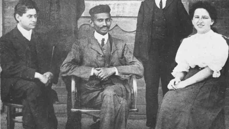 Mohandas Gandhi (center) sits with co-workers at his Johannesburg law office in 1902.