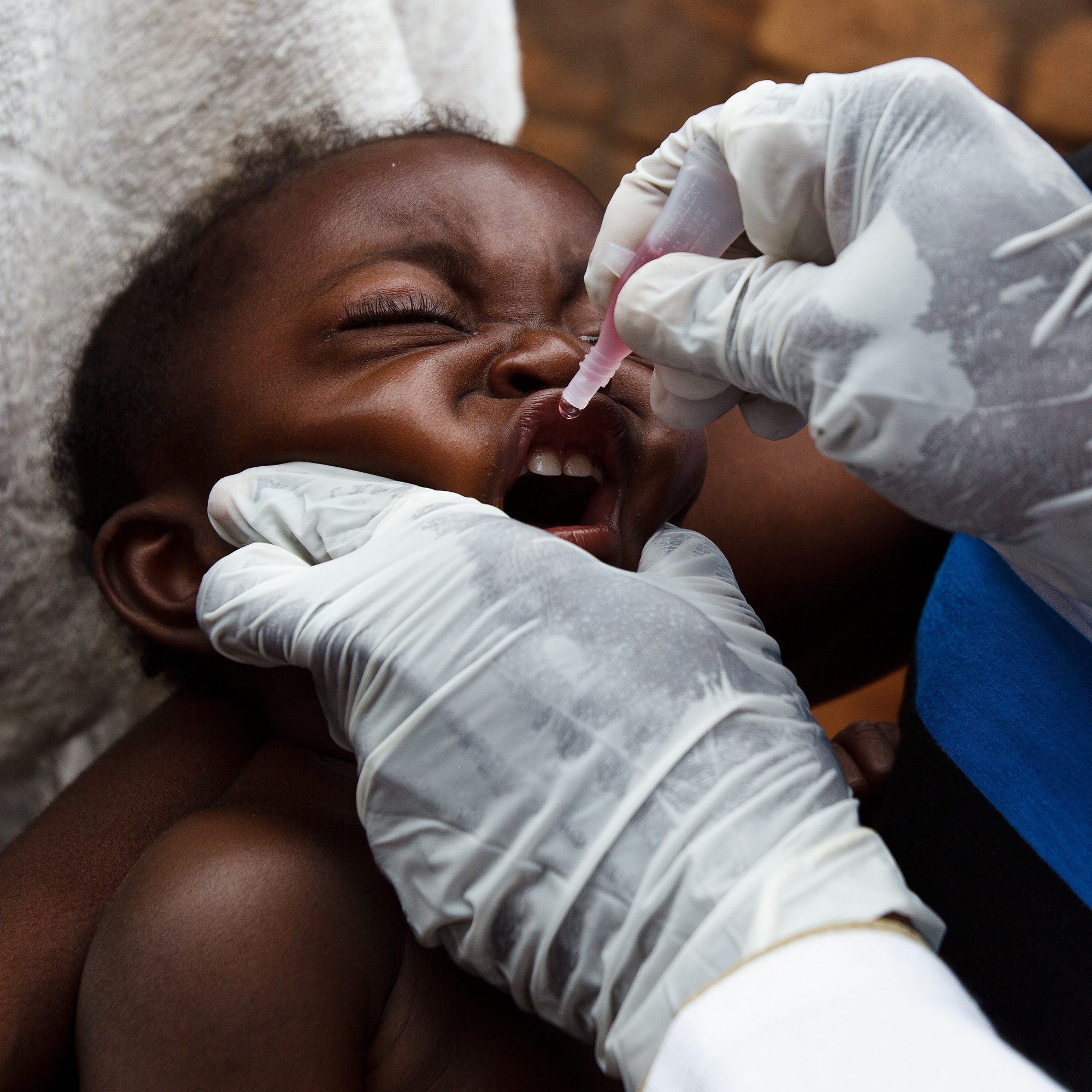 A child reluctantly receives a polio vaccine at a clinic in Nyunzu, Democratic Republic of Congo, in 2012. A polio outbreak that year killed 190 people in the Central African country.