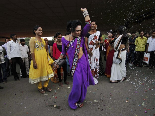 An Indian eunuch in the eastern city of Bhubaneswar dances Tuesday to celebrate the Supreme Court's ruling recognizing a third gender category.