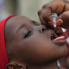 A child receives a polio vaccine Sunday in Kano, Nigeria. The country is the primary source of the virus in Africa but appears to be making progress against the disease; the current outbreak in Cameroon that has spread to Equatorial Guinea came by way of Chad, not Nigeria.