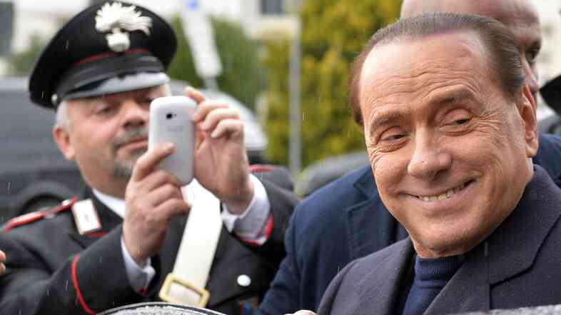 Former Italian Prime Minister Silvio Berlusconi was all smiles last month at Ciampino Airport near Rome.