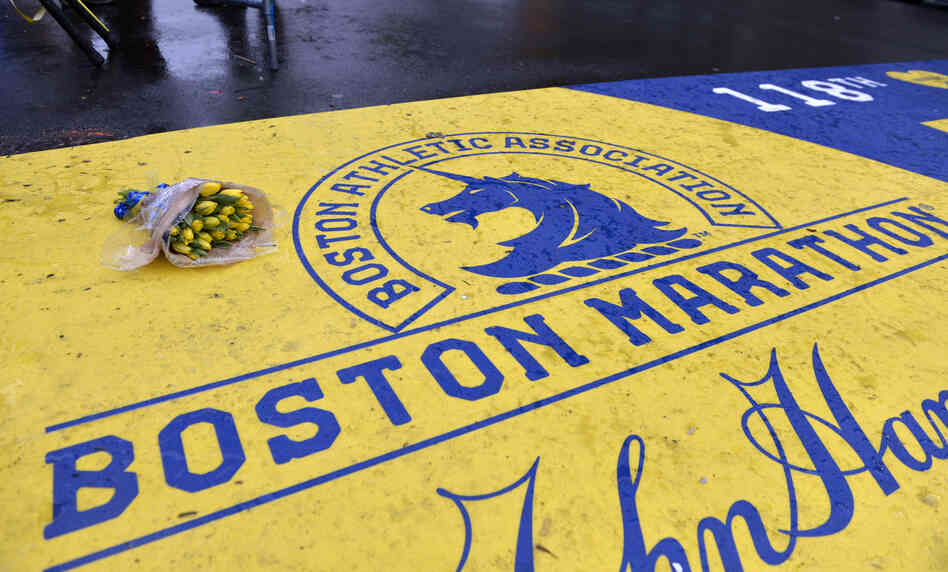 Flowers rest on the finish line of the Boston Marathon Tuesday.