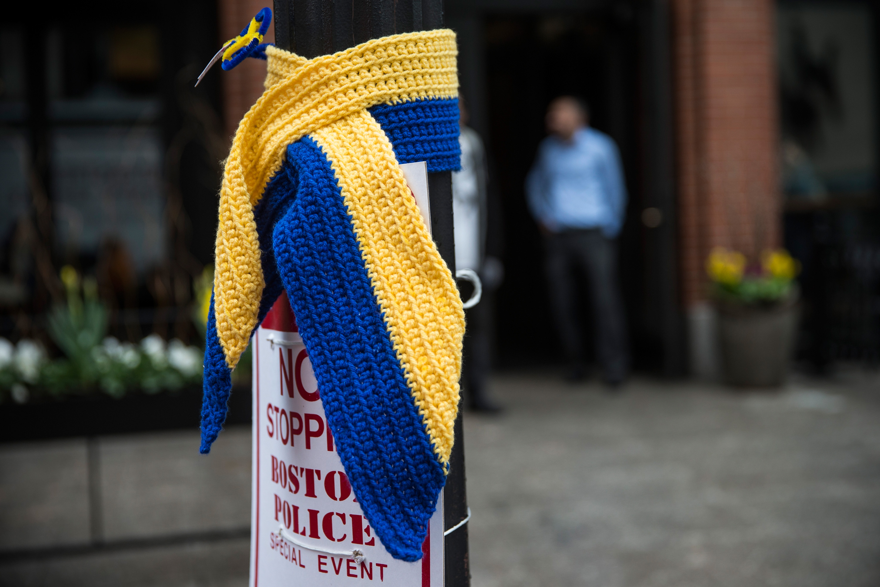 A knitted tribute hangs on a street light along the course of the Boston Marathon on April 15, just one of many tributes being made today in honor of the attack's victims.