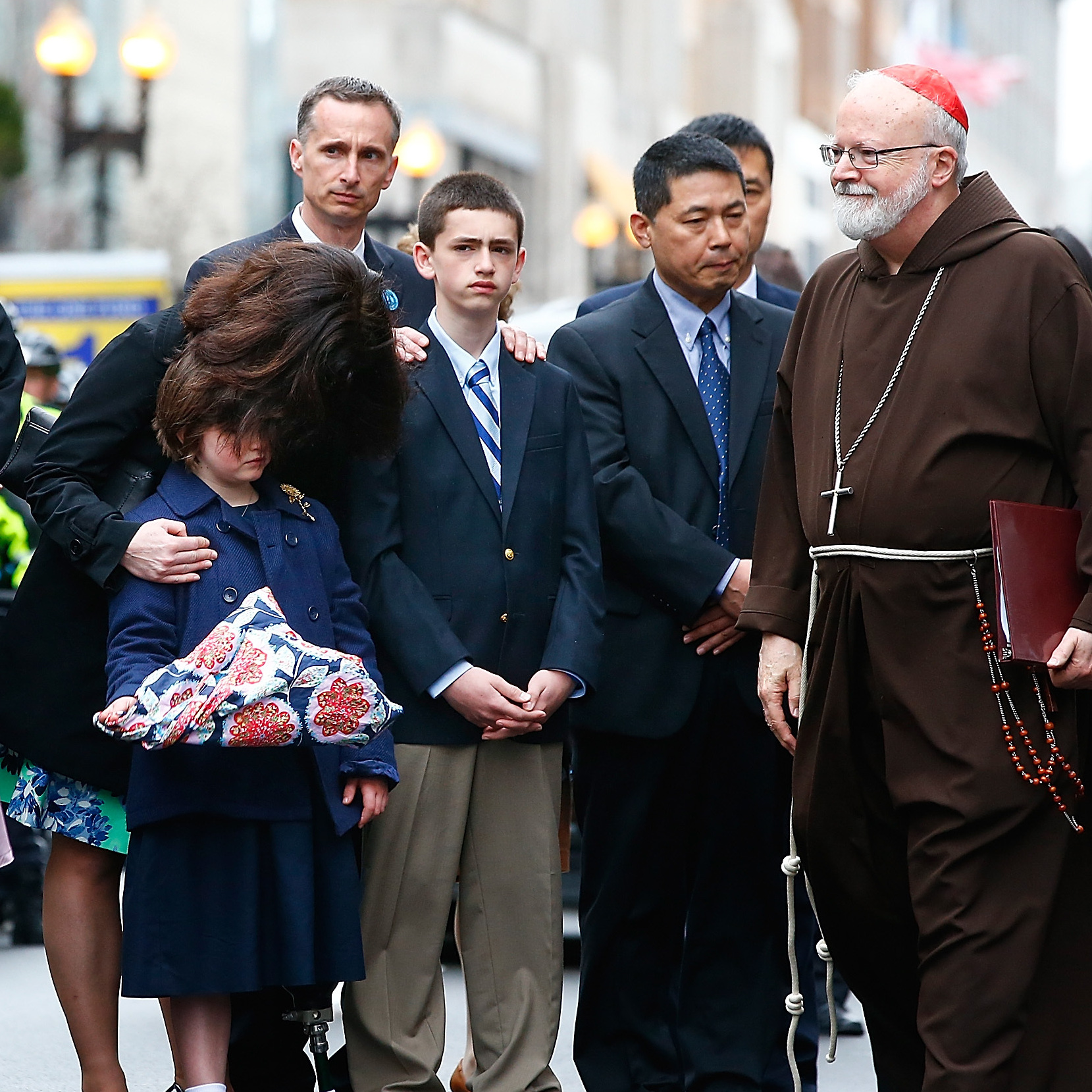 One year after the Boston Marathon bombings, families of the victims, including relatives of Martin Richard, attended a wreath-laying ceremony on Boylston Street along with Mayor Martin Walsh (left) and Cardinal Sean Patrick O'Malley (right).