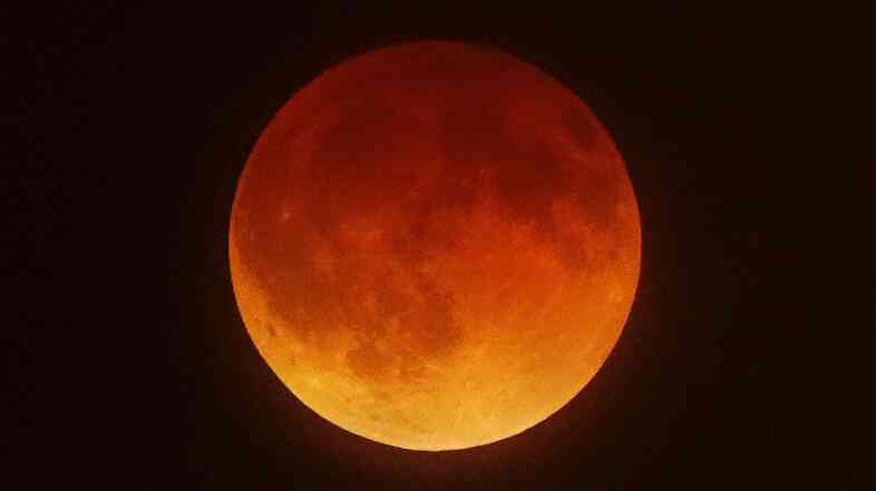 "The ""blood moon"" as seen from Koreatown, west of Los Angeles, early Tuesday. The next total eclipse of the moon comes on Oct. 8."