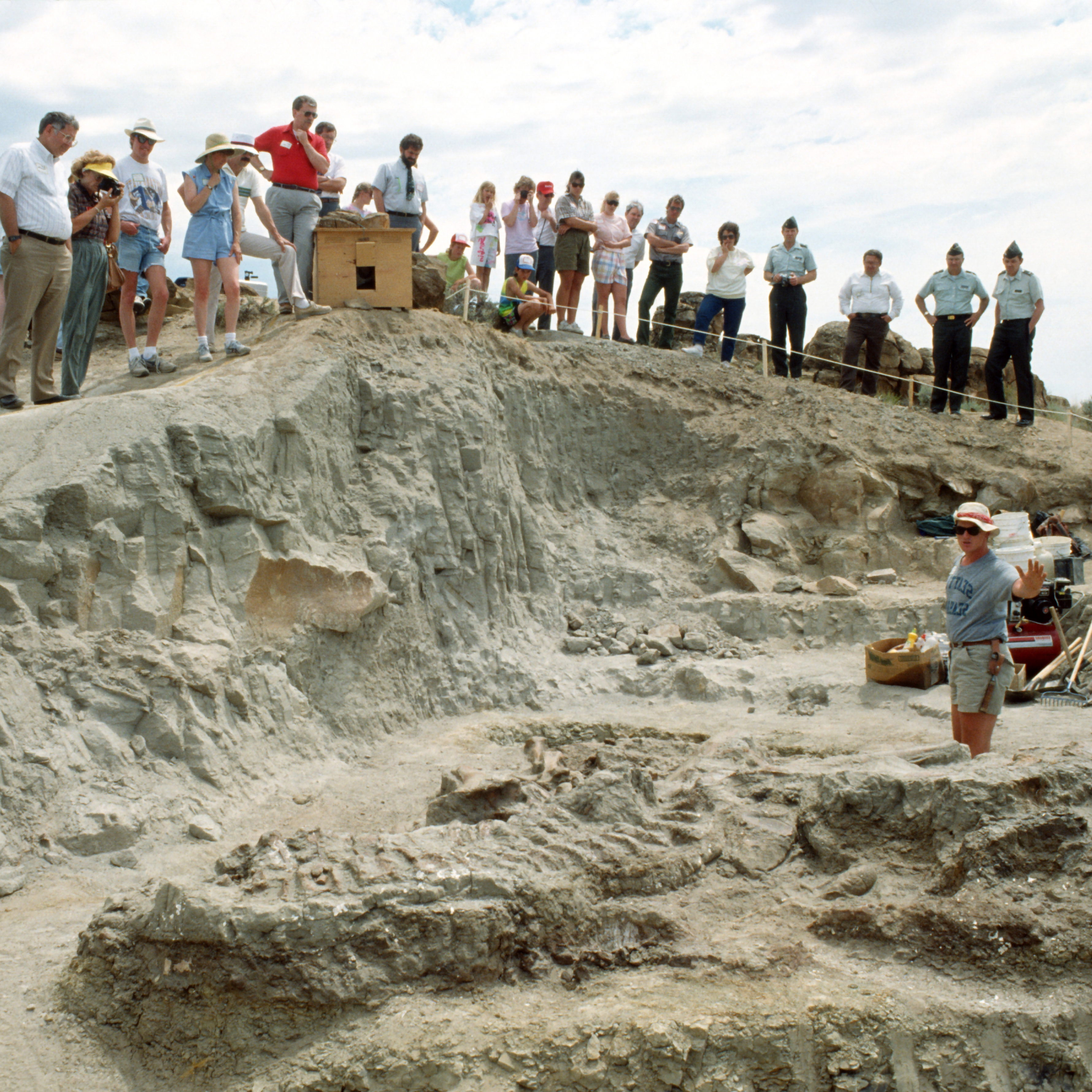 Graduate student Scott Sampson (foreground) describes skeletal structures of the exposed Wankel T. rex fossils near Fort Peck, Mont., in June 1990. The specimen was found by rancher Kathy Wankel.