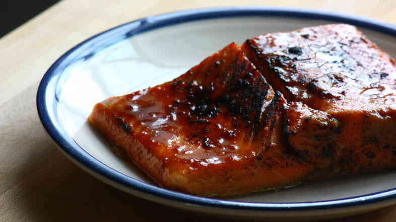A salmon fillet cooked sous vide, with miso-ginger glaze, gets a crisp finish under a broiler or torch flame.