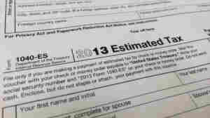 Proposals that would simplify the filing process for many Americans are under fire from tax preparation company TurboTax. Here, a 2013 IRS Estimated Tax form.