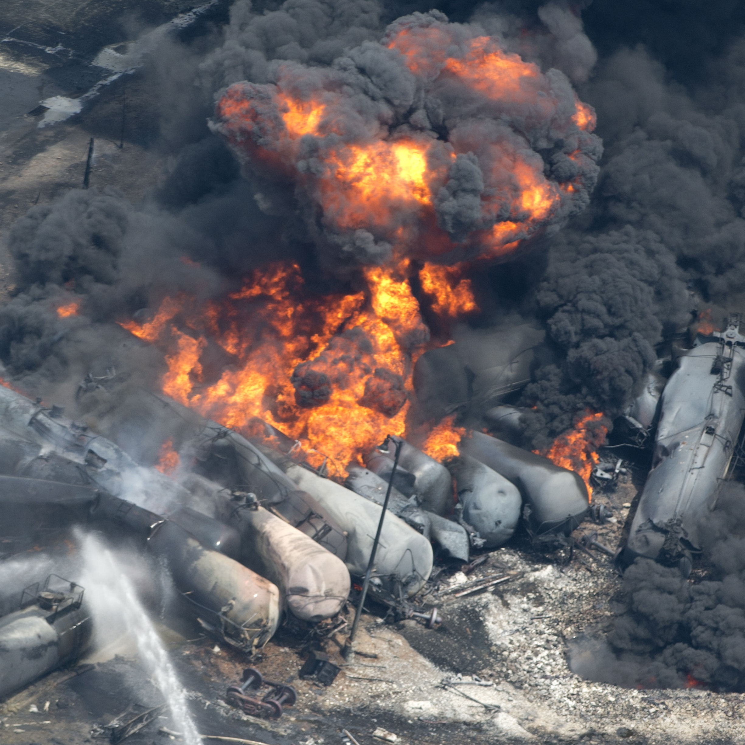 Smoke rises from tanker cars carrying crude oil after a derailment in downtown Lac-Megantic, Quebec, in July.