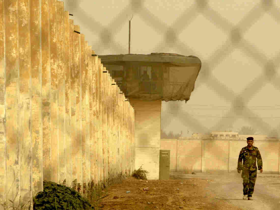 An Iraqi security officer patrols the grounds at Baghdad Central Prison in Abu Ghraib in 2009.