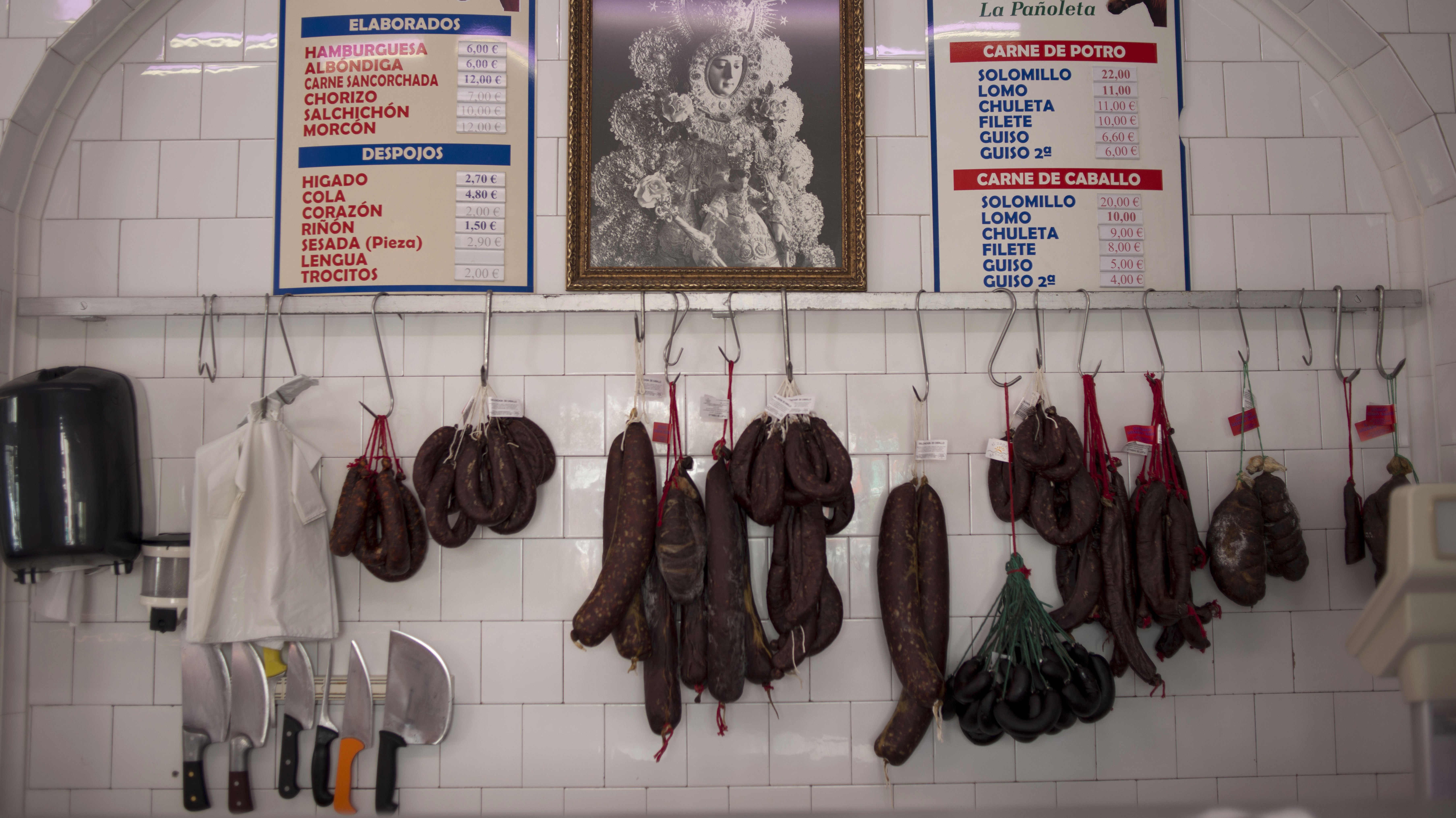 Cured sausage meats from horses hang in a horse butcher in Camas, Spain.