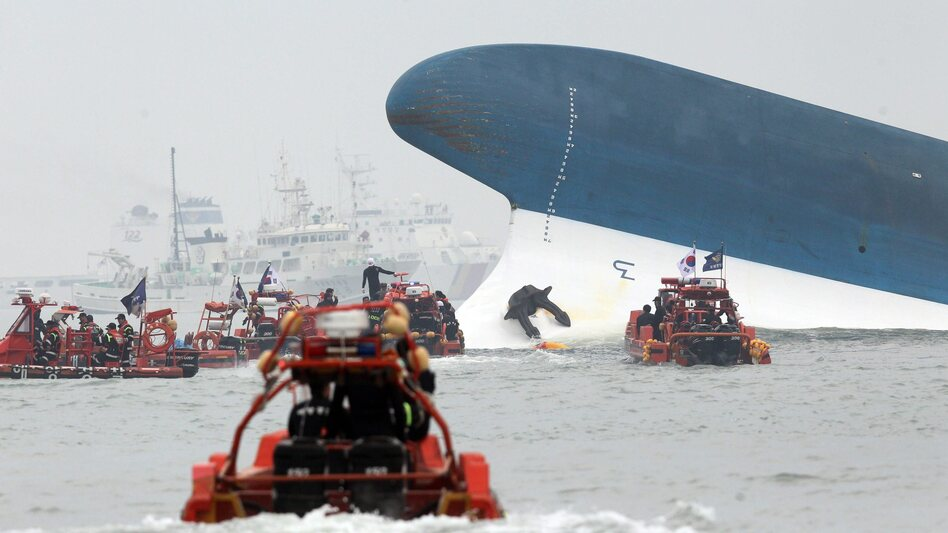 Rescuers head toward the ferry Sewol off the southern coast of South Korea on Wednesday. It sank while on a trip to a resort island. Several hundred people, most of them high school students and teachers, are missing.