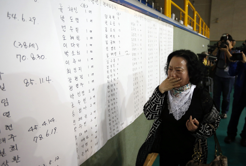 The mother of a passenger reacts as she finds her son's name on a list of survivors posted in a gym where rescued passengers gathered in Jindo. (Reuters /Landov)