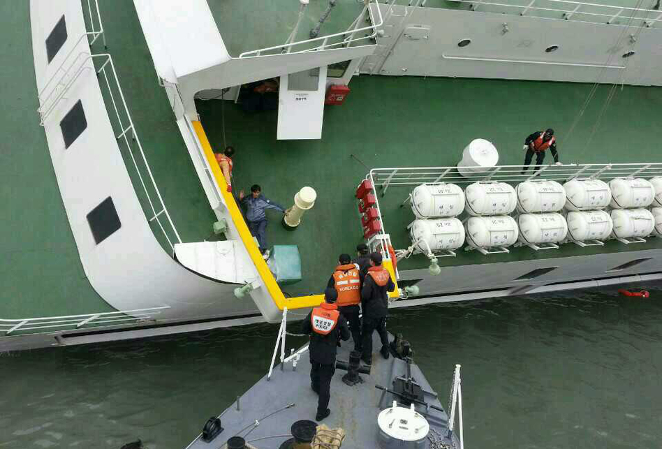 Passengers are taken to safety by South Korea's coast guard.  (Getty Images)