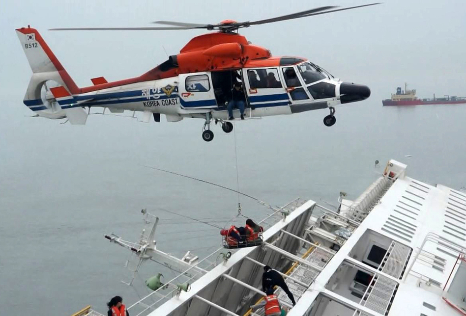A maritime police helicopter was used in the rescue efforts. According to NPR's Anthony Kuhn, most of the ship was under water about two hours after rescuers arrived. (Reuters/Landov)