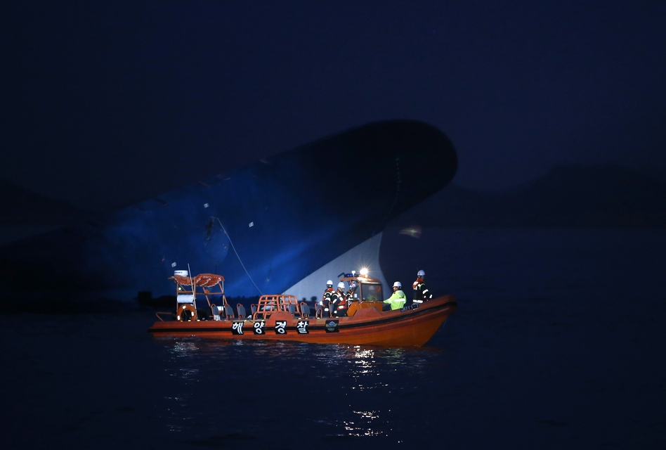 Maritime police search for passengers. Hours after the ferry capsized, close to 300 people were still missing off the southern coast of South Korea. (Reuters/Landov)