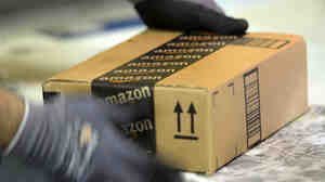 An employee prepares an order at Amazon's fulfillment center in San Bernardino, Calif.