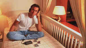 Enrique Iglesias listens to sweet, sweet jams on a portable cassette player, long before you were born.