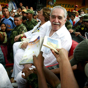 "Admirers ask Gabriel Garcia Marquez --€"" seated alongside his wife, Mercedes Barcha €-- to sign books in Santa Marta, Colombia, in 2007."