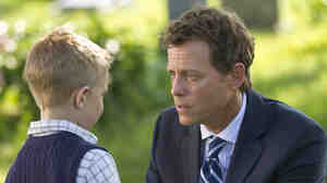 Colton Burpo (Connor Corum) tells Todd (Greg Kinnear) about heaven in Heaven Is for Real.
